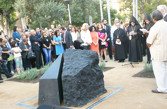 Clergy and organizers gathered after the unveiling of the Armenian Genocide Monument at Grand Park in Los Angeles