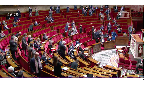 Members of France's National Assembly applaud the vote to recognize Artsakh